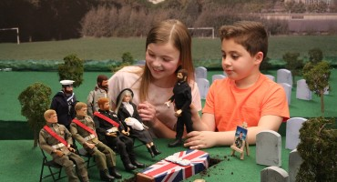 Children playing with Action Men figures.