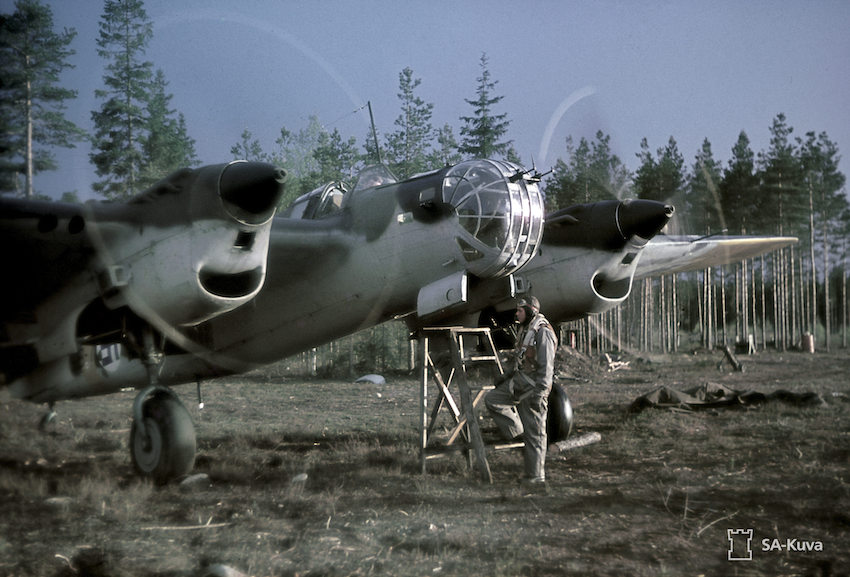 SB-2 bomber on air field, engines running