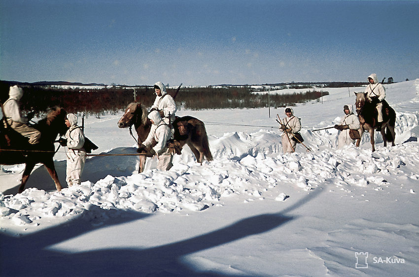 The men of the Häme Cavalry Regiment(HRR) on horseback and skiing.