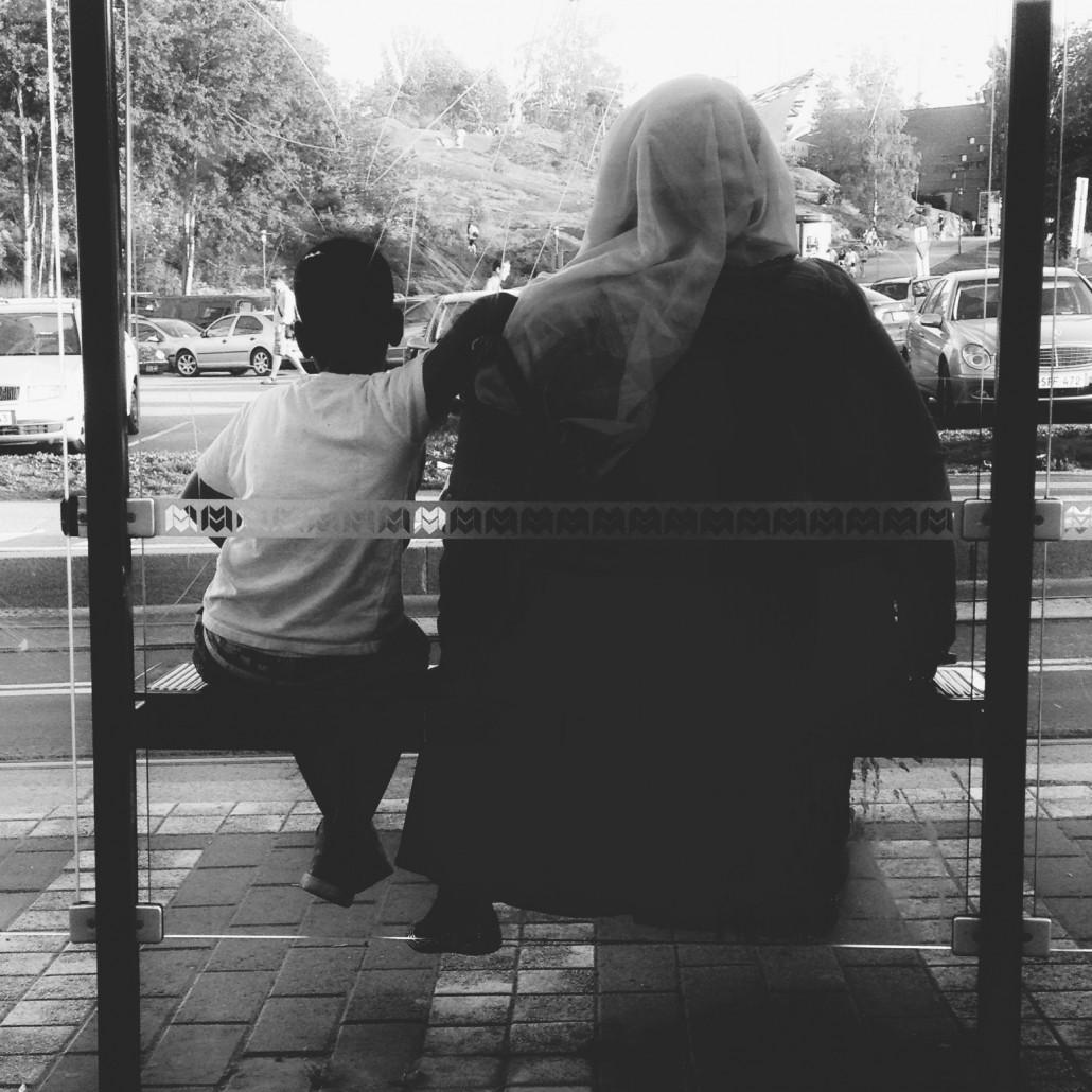 Woman and child at tram stop, Linnanmäki, Helsinki. Photo by Taru Latva-Pukkila.