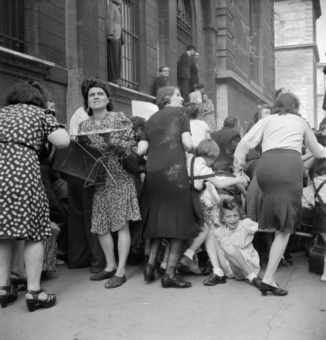 Mothers shield their children from German sniper fire. (Paris, France 1944)