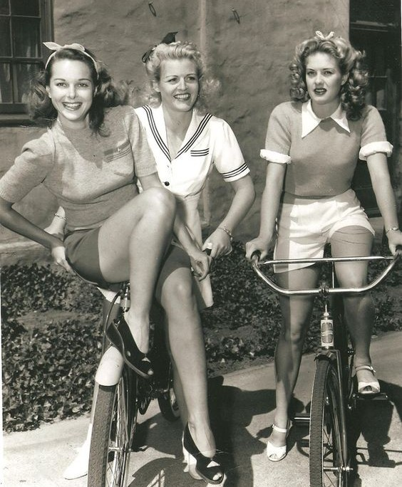 Trendy 1940's ladies on their bikes
