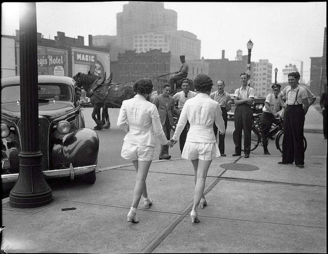 Two women showing their uncovered legs in public for the first time in Toronto. [1937]