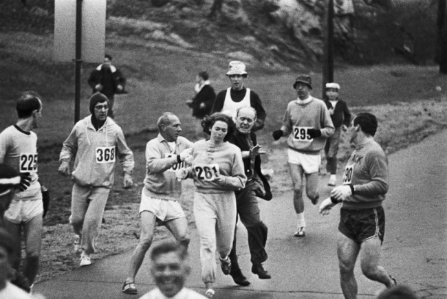 When organizer Jock Semple realized a woman was running the Boston marathon he went after her. Other runners blocked him and Kathrine Switzer went on to finish the race(1967)