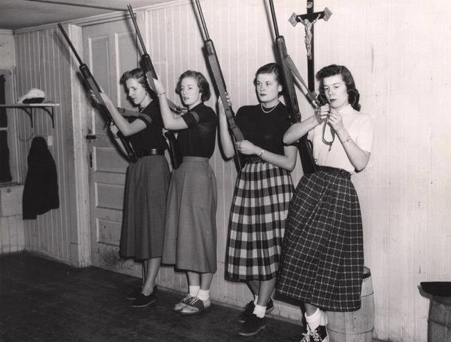 Girls with their rifles to protect their homes.