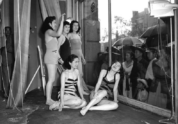 To draw people's attention to a new line of bathing suits, a department store in Tokyo used human models instead of mannequins to show off the suits. June 5, 1950.