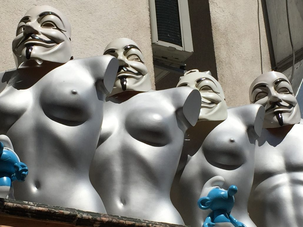 "Topless sttues in ""Anonymous"" Guy Fawkes masks"
