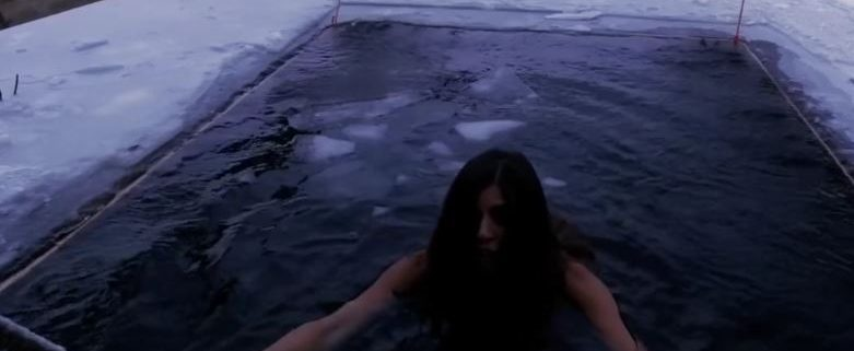 Christina Macfarlane of CNN trying ice dipping in Finland