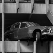 Vintage Jaguar parking garage crash