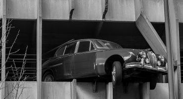 Vintage Jaguar parking garage crash