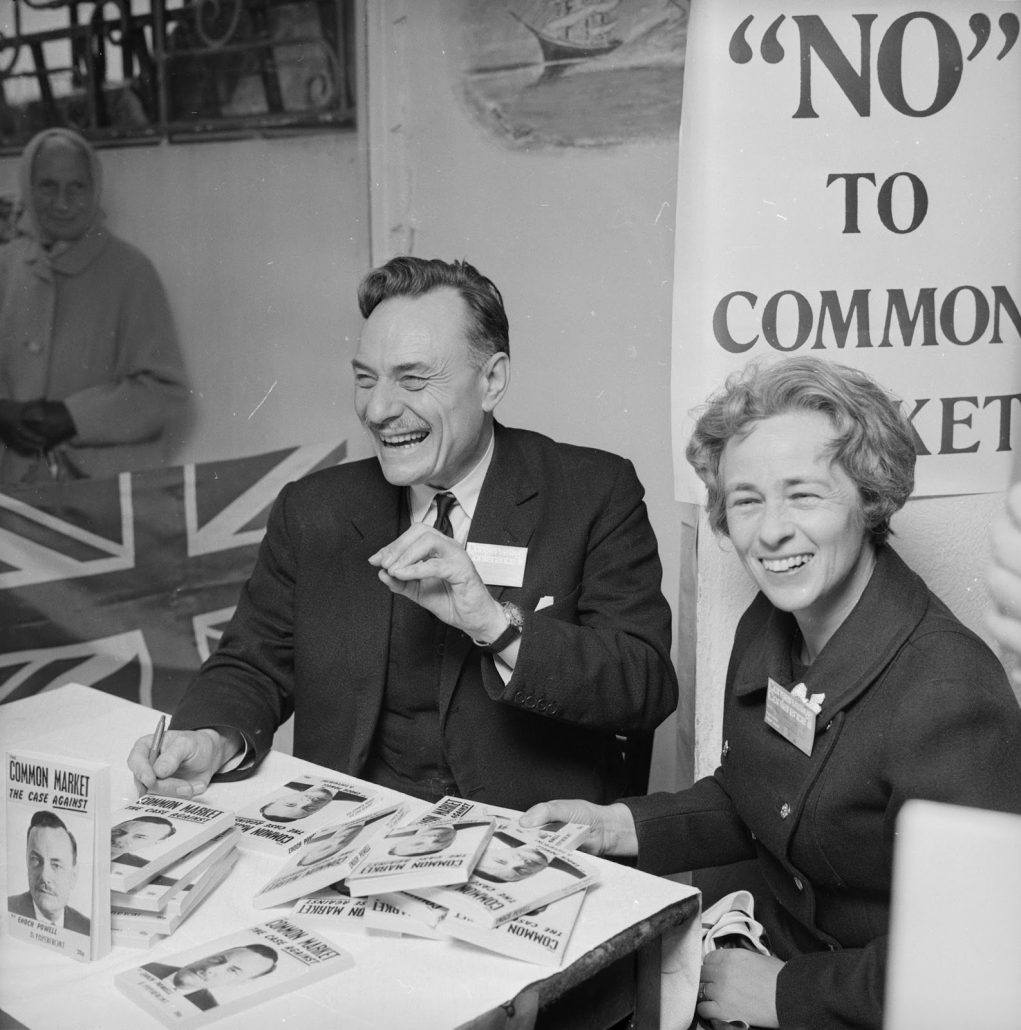 13th October 1971: English Conservative politician, (John) Enoch Powell (1912 - 1998 ) with his wife as he signs copies of his book 'Common Market - The Case Against' during the Conservative Party Conference in Brighton. (Photo by Central Press/Getty Images)