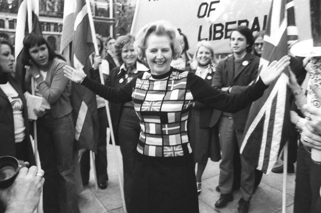 Margaret Thatcher, sporting a sweater bearing the flags of European nations, in Parliament Square during her 'Yes to Europe' campaign.
