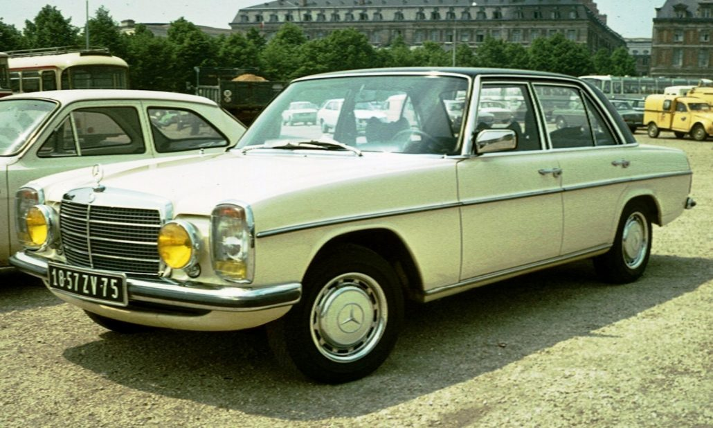 70's photo of 1973 Mercedes Benz W 114 at Versailles, France.