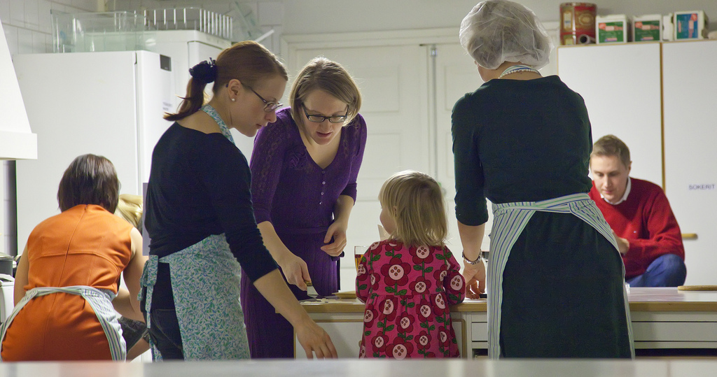 Finnish family with kids preparing Christmas dishes