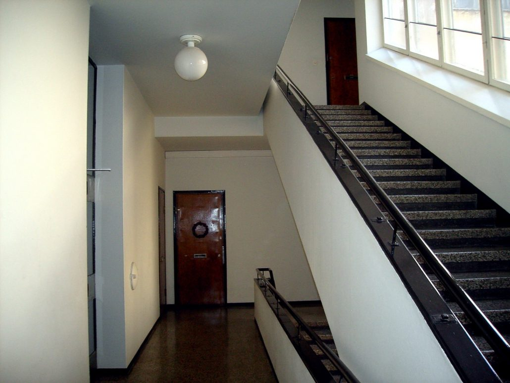 Finnish apartment block staircase in Punavuori, Helsinki. One of the doors has a traditional Christmas decoration.