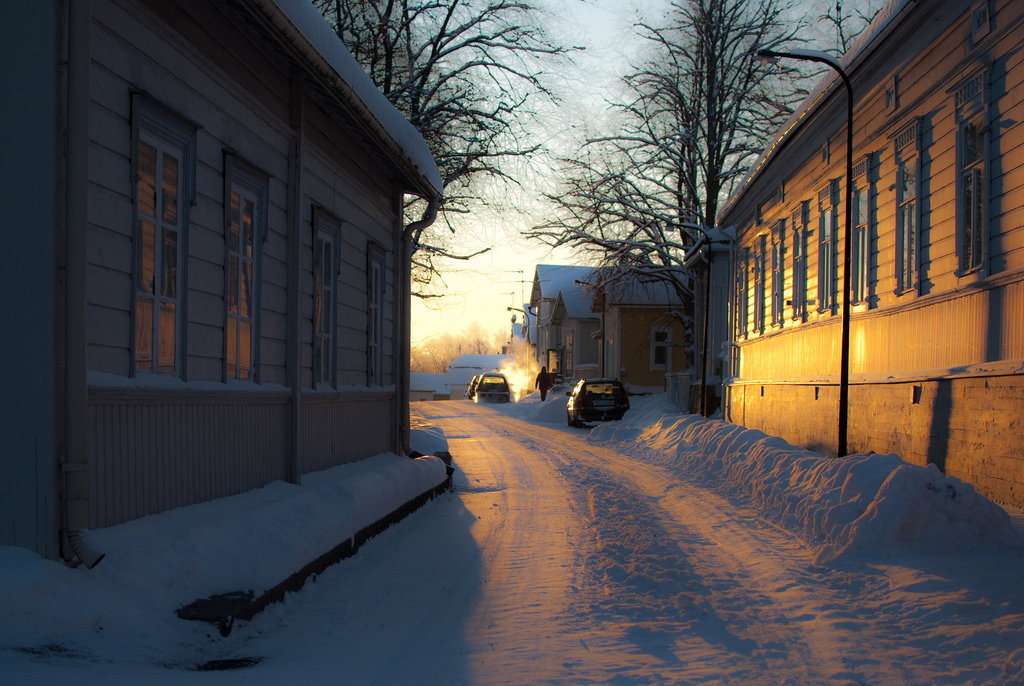 Winter sunrise in a snowy small town street in Loviisa, Finland.