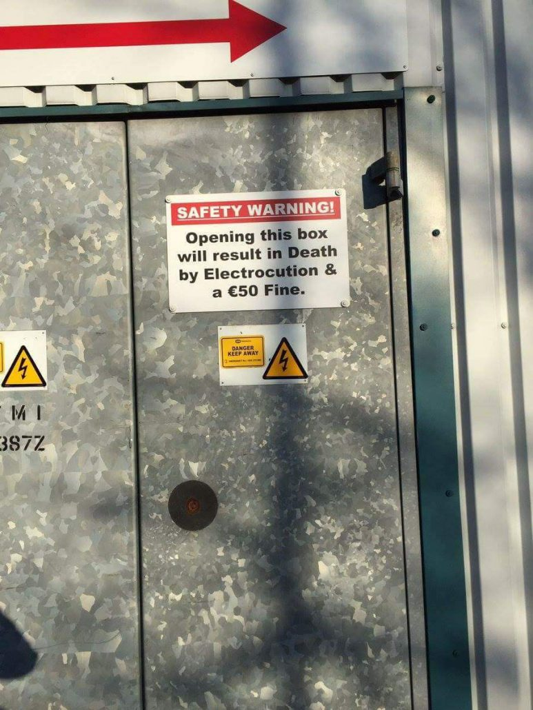 Warning sign: opening door results in both electrocution to death and fine