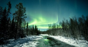 Jani Ylinampa's photo of northern lights over a small river in Lapland, Finland