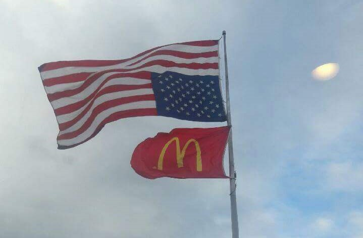 Upside down USA flag at Mcdonald's flag pole