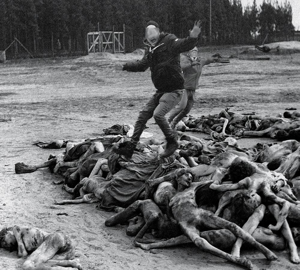 Young men jumping at dead victims of the Holocaust