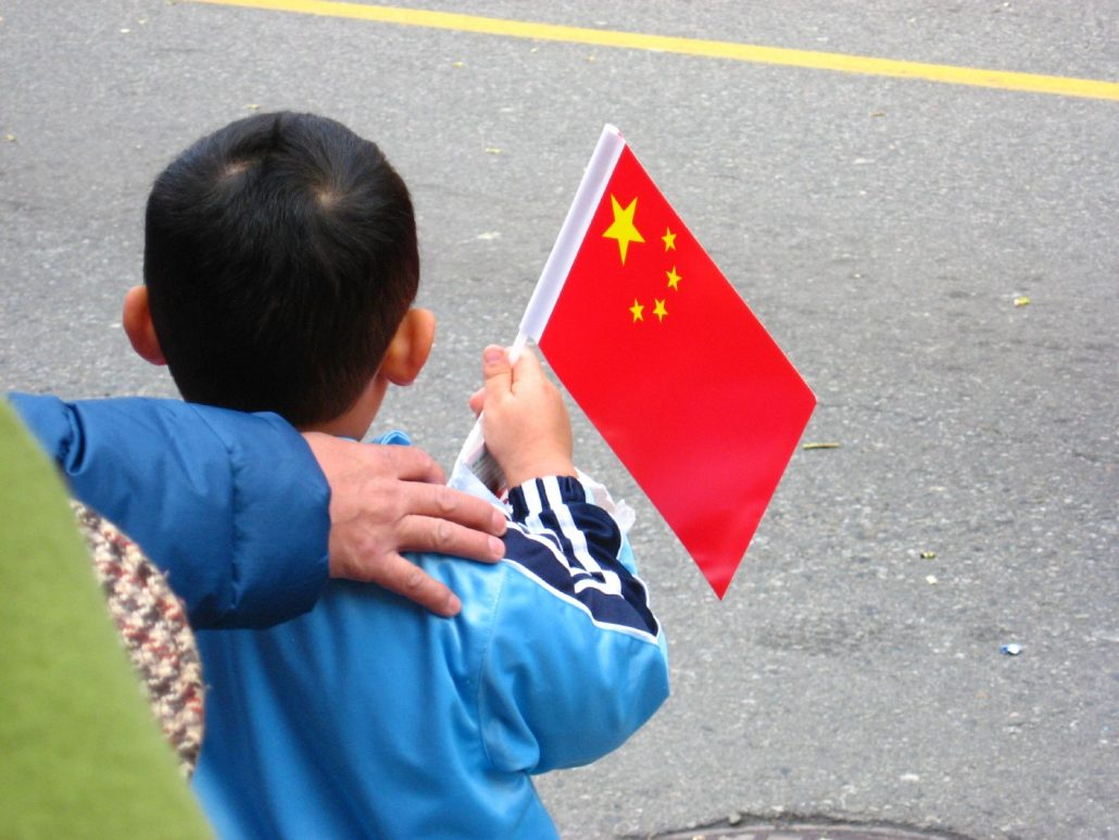 asian child holding chinese flag