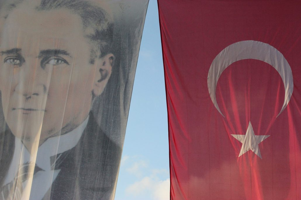 Ataturk pictured beside Turkish flag