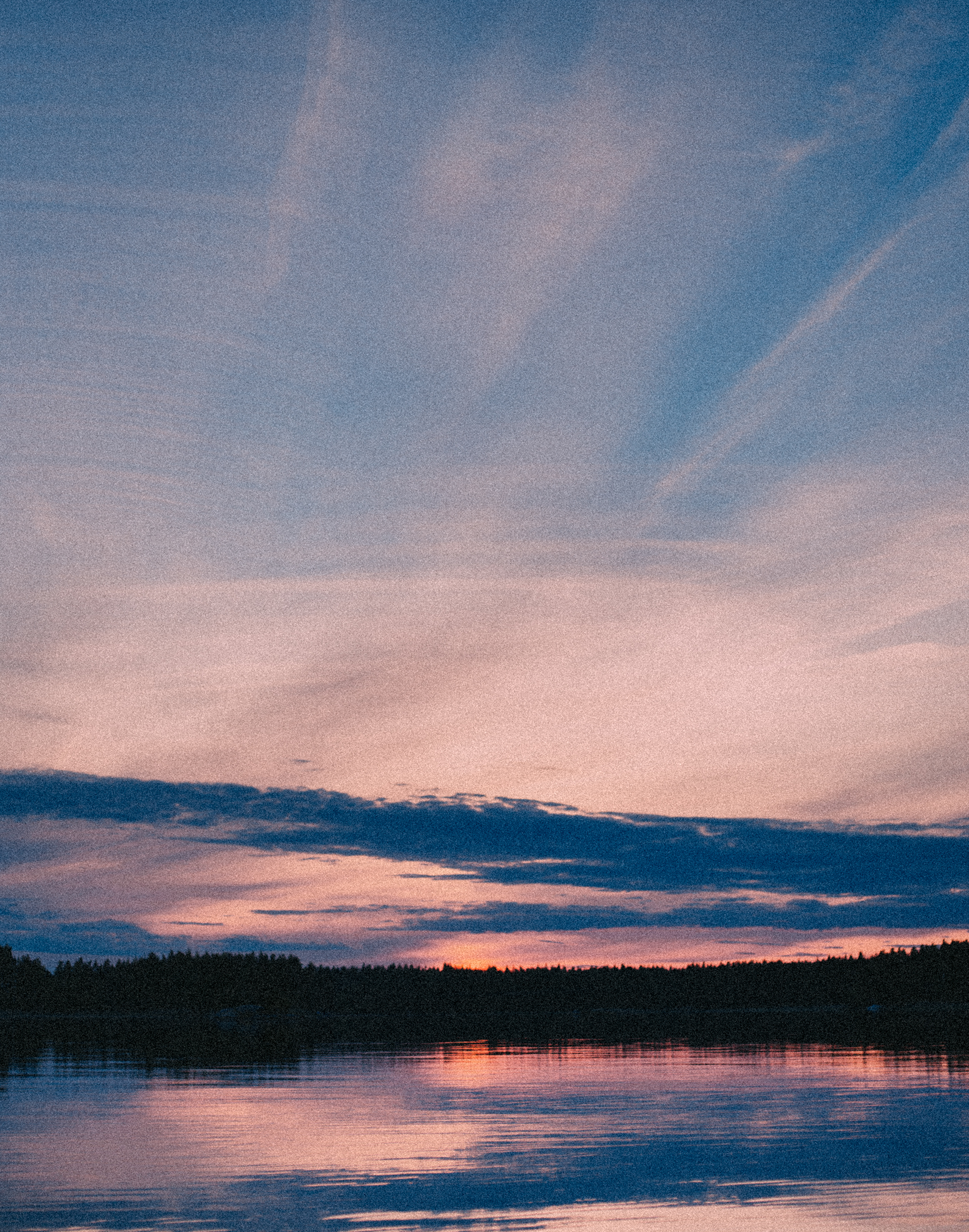 Midsummer sunset in lake landscape