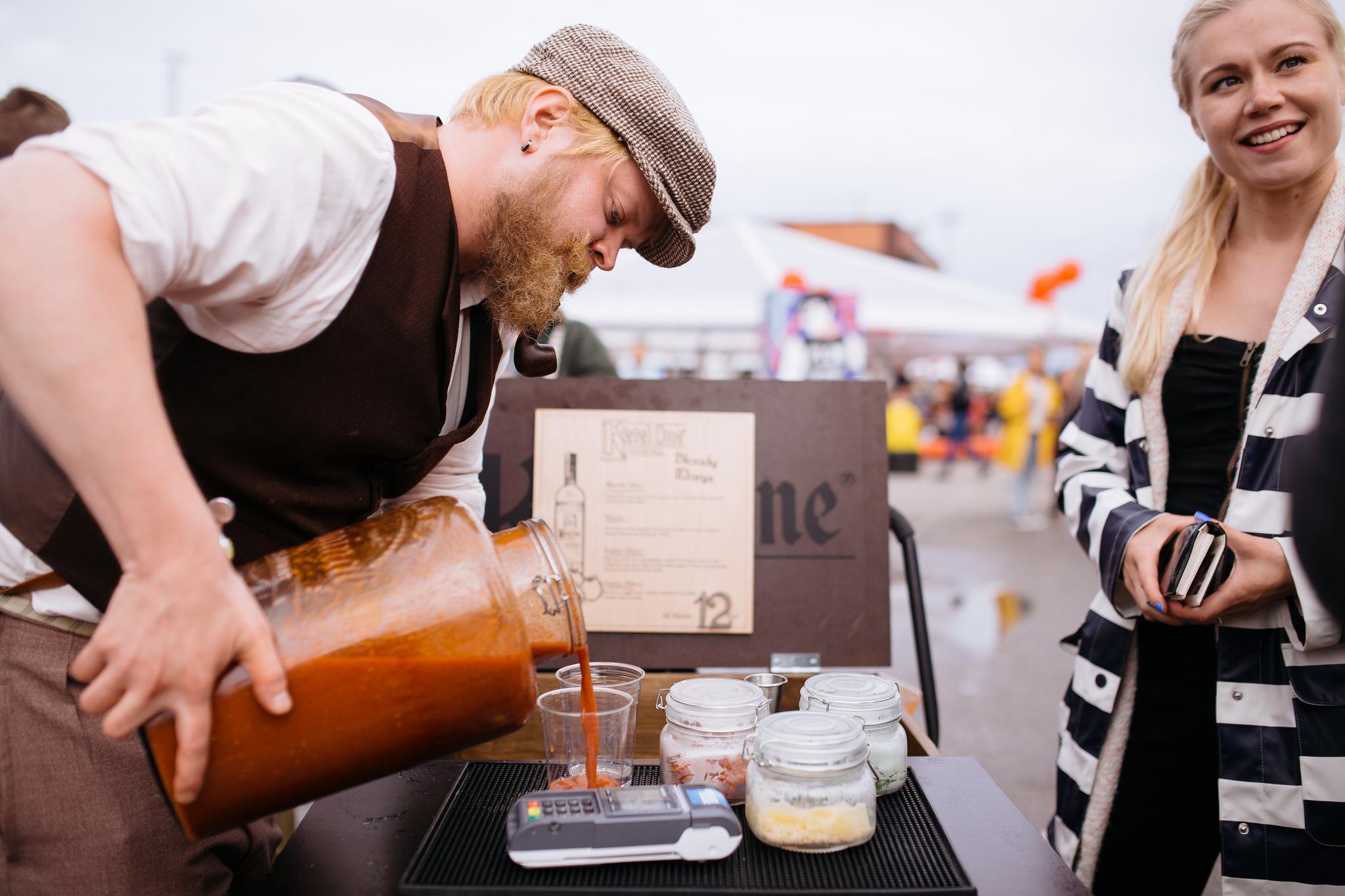 Man pouring artisanal beverage at Flow Festival