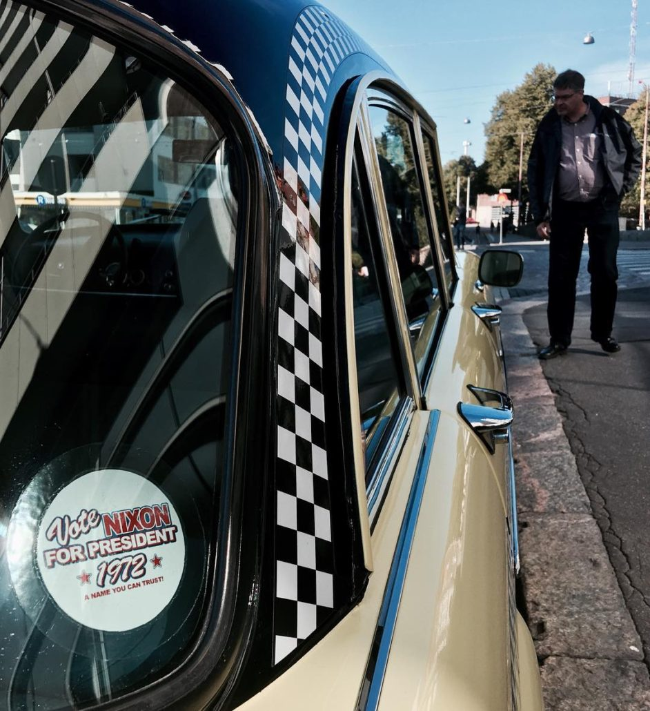 Checker cab with Nixon '72 presidential campaign sticker in Kallio, Helsinki