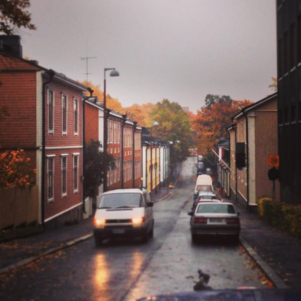 Rainy October day in Puu-Vallila. The sky is gray but the wooden early 20th century houses are colorful
