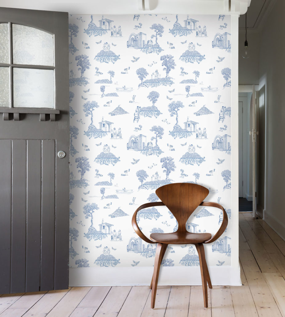 Finland Toile wallpaper by Feathr in photo depocted behind a wooden chair