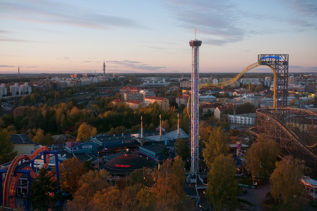 Autumnal evening flyover shot of the Linnanmäki amusement park in Helsinki