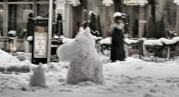 Moomin snowmen in urban setting. Photo by Spixey on Flickr.