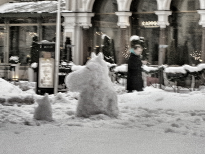 Two Moomin snowmen in urban setting. Photo by Spixey on Flickr.